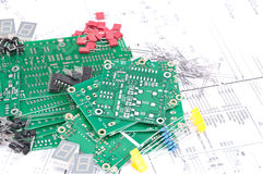 Circuit boards, components with schematics Stock Images