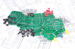 Circuit boards, components with schematics. Circuit boards and electronic components with schematics in background Stock Photography