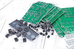 Circuit boards and components with schematics. Circuit boards and electronic components with schematics in background Royalty Free Stock Image