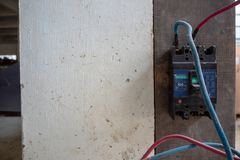 Circuit breaker install on wall with cables connect to machine stock photography
