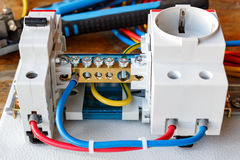 Circuit breaker, wire terminal block and electrical socket with connected wires Stock Images