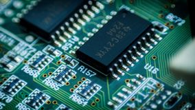 Circuit plate closeup industry. Chip electronic industry green macro manufacturing Stock Images