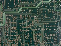 Circuit Traces and Vias. On a green circuit board Stock Images