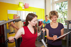 Circuit training in gym. Mixed group doing circuit training in a gym Royalty Free Stock Photos