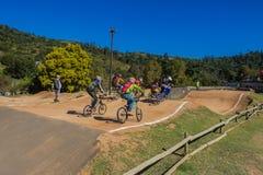 Circuito de carreras de los jinetes de BMX Fotos de archivo libres de regalías