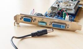 Circuitos electrónicos y enchufe Imágenes de archivo libres de regalías