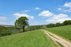 The circuitous pathway to Stannage Edge, in idylic Haversage, Derbyshire. Taken on a sunny spring day, this captures a beautiful pastoral and picturesque view Stock Photos
