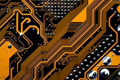 Circuits of a motherboard. Detail of the circuits of a computer motherboard stock images