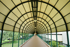 Circular arch patterns taken on a skybridge Stock Photo