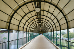 Circular arch patterns taken on a skybridge Stock Photography