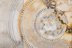 Circular bas-relief on marble. Classic italian adornment carved on marble slab Royalty Free Stock Photos