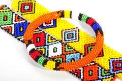Circular Beaded Zulu Armband Atop Two Wristbands Stock Image