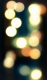 Circular bokeh lights background in golden tones Stock Image