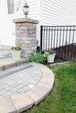 Circular brick step onto an outdoor patio Stock Image
