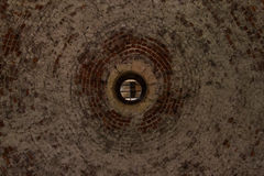 Circular brick vault with hole for light in Angera fortress Stock Images