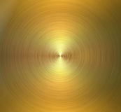 Circular brushed metal texture. Golden shiny background Stock Image