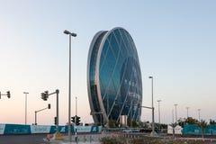 Circular building in Abu Dhabi. ABU DHABI - DEC 19: Aldar Headquarters circular building in Abu Dhabi. December 19, 2014 in Abu Dhabi, United Arab Emirates Stock Photo