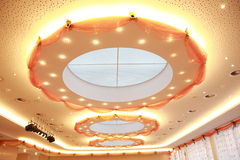 Circular Ceiling Lights. Ceiling light. The light is arranged around a circular window in the ceiling of a senior-residence dining room  The artificial light is Stock Image