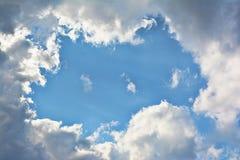 Circular Clouds. Around a blue sky opening Stock Photos