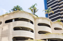 Circular Concrete Parking Garage in Tropics. With Palm Trees Stock Photos