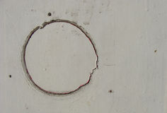 Circular crack damage on white grungy panel Royalty Free Stock Image