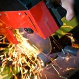 Circular cutting saw in action stock photos