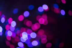 Circular defocused lights. Pattern of defocused blue and red lights Stock Photos