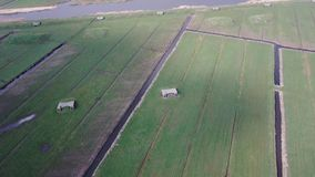 Aerial video of meadow in reclaimed land with second world war bunkers