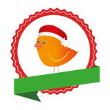 Circular emblem with ribbon and bird with christmas hat Stock Image