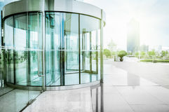 The circular entrance. The revolving door of glass manufacturing of modern architecture Royalty Free Stock Photography