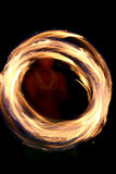 Circular fire dancing. A hawaii native dances with fire in the night time with motion blur Stock Photography