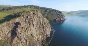 Circular flight over the rocky cliff of Baikal stock video