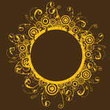 Circular frame. A yellow-orche, circular frame on a brown background. The frame is made up of circles and curves Royalty Free Stock Images