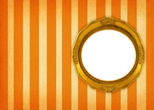 Circular frame. Hollow gilded circular frame on retro background royalty free stock image