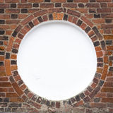 Circular frame in old brick wal Royalty Free Stock Image