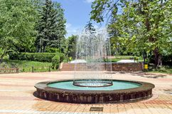 Circular garden fountain Stock Photos