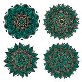 Circular green patterns with decorative elements Stock Photography