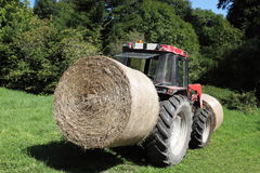 Circular Hay Bale On Rear Of Tractor Royalty Free Stock Photography