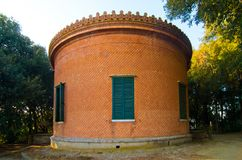 Circular historic clay building, minerva temple. A historic circular building built in clay with inclined opus and Masonic decorations on top royalty free stock image