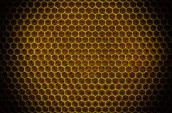 Circular honeycomb background. Elliptic gradient. Circular honeycomb background. Elliptic dark gradient beeswax Royalty Free Stock Photo