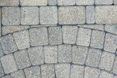 Circular inlaid pattern in grey brickwork Stock Photo