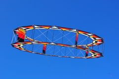 Circular kite flying in a blue sky Royalty Free Stock Photography
