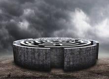 Circular labyrinth. 3D circular labyrinth against dark cloudy sky Stock Photography