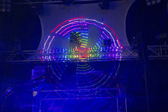 Circular laser light effect. Bright coloured circular nightclub laser  shot in darkened club looking towards stage Royalty Free Stock Image