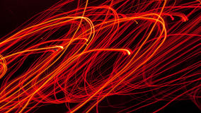 Circular lines of fire. Many small light sources with long exposure produce this abstract wavy pattern Royalty Free Stock Image