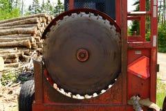 Circular Log Cutoff Saw. Log slasher saw on landing stock photo