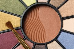 Circular makeup pallet. A circular makeup pallet and brush Royalty Free Stock Images
