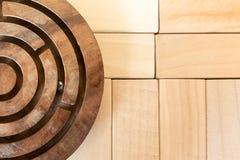 Circular maze on the wood puzzle Stock Photos