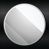 Circular metal plaque. Glossy silver plaque on a metallic black background Royalty Free Stock Photo