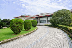 Circular mosaicked way to hilltop modern building in sunny autum. N,Chengdu,China Stock Photo